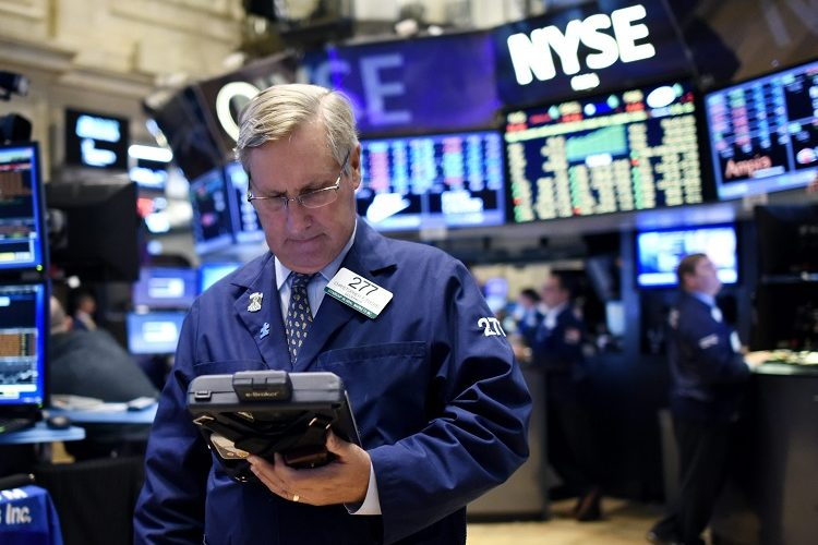 epaselect epa04965021 Traders work on the floor of the New York Stock Exchange at the end of the trading day in New York, New York, USA, on 05 October 2015. The Dow Jones industrial average gained a little over 300 points in the day. EPA/JUSTIN LANE