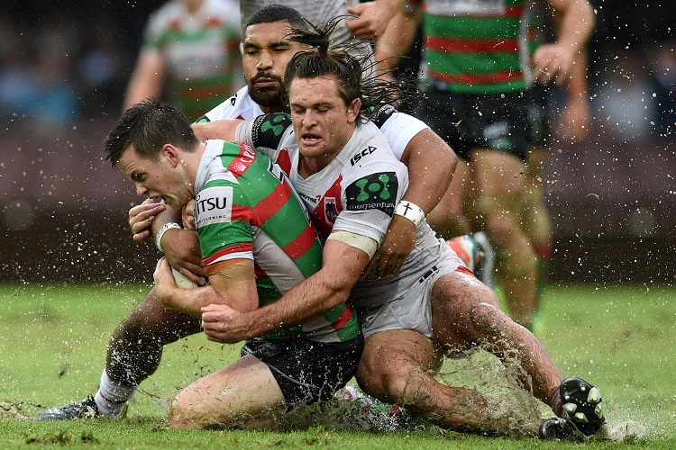 Luke Keary (left) of the Rabbitohs is tackled by Mitch Rein (right) and Tyson Frizell of the Dragons during the round 3 NRL match between the St George Illawarra Dragons and the South Sydney Rabbitohs at the Sydney Cricket Gound in Sydney on Sunday, March 20, 2016. (AAP Image/Paul Miller) NO ARCHIVING, EDITORIAL USE ONLY
