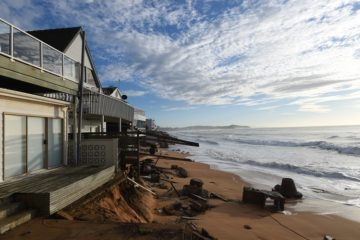 Damaged beach front homes along Pittwater Road sustained further damage overnight following the king tide and large waves at Collaroy on the northern beaches in Sydney, Tuesday, June 7, 2016. The mop up continues across NSW after powerful storms smashed the state's coast, leaving three men dead and many homes significantly damaged. (AAP Image/Dean Lewins) NO ARCHIVING