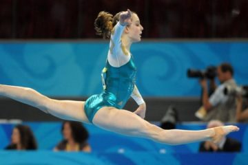 Australian gymnast Lauren Mitchell jumps during her routine at the floor exercise at the team event final at the Olympic Games in Beijing, China, Wednesday, Aug. 13, 2008. Australia finished sixth. (AAP Image/Dan Peled) NO ARCHIVING, EDITORIAL USE ONLY, NO COMMERCIAL USE