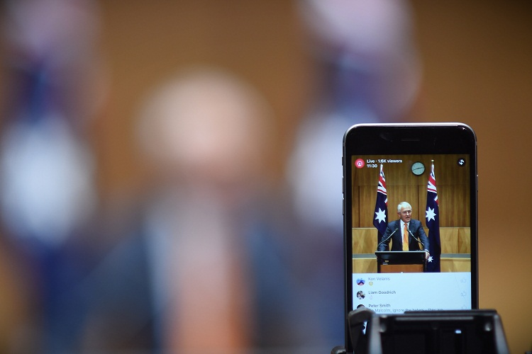 Australian Prime Minister Malcolm Turnbull is seen of a screen during a press conference at Parliament House in Canberra, Sunday, May 8, 2016. Mr Turnbull today asked the Governor-General to dissolve both Houses of Parliament to call a double dissolution election for July 2, 2016. (AAP Image/Lukas Coch) NO ARCHIVING