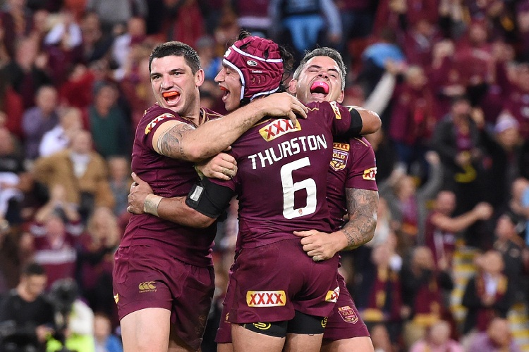 (L-R) Matt Gillett, Johnathan Thurston and Corey Parker of the Maroons celebrate winning Game 2 and the State of Origin series against the NSW Blues at Suncorp Stadium in Brisbane, Wednesday, June 22, 2016. (AAP Image/Dave Hunt) NO ARCHIVING, EDITORIAL USE ONLY