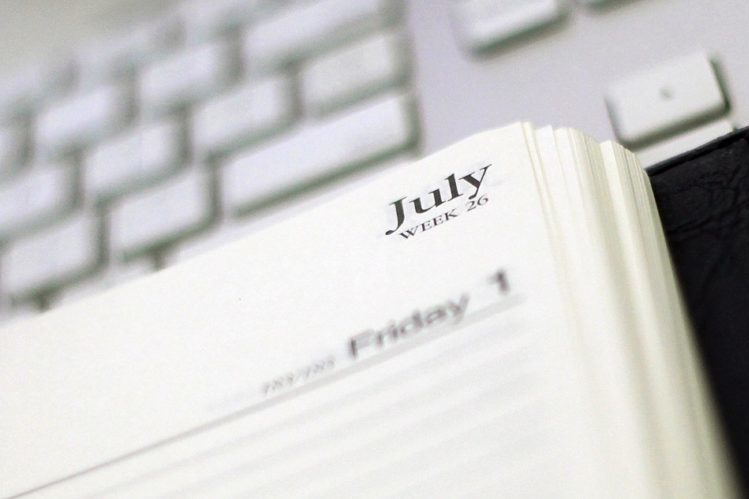 A 2015-2016 financial year diary is featured with reading glasses in a stock image in Sydney, Wednesday, Jan. 13, 2016. (AAP Image/Sam Mooy) NO ARCHIVING