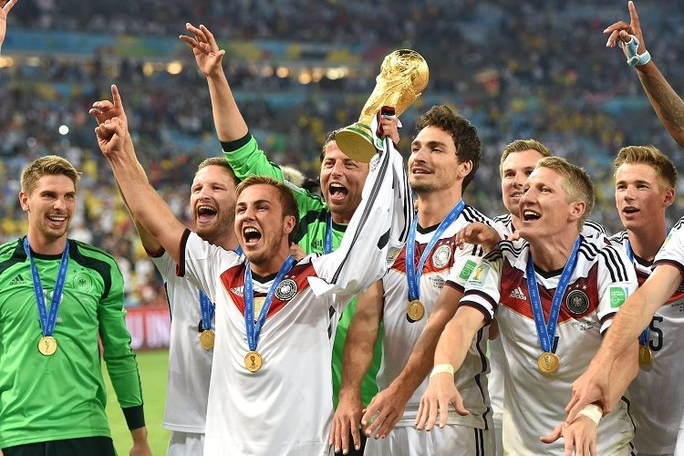 epa04315020 Mario Goetze (C) of Germany and his teammates celebrate with the World Cup trophy after the FIFA World Cup 2014 final between Germany and Argentina at the Estadio do Maracana in Rio de Janeiro, Brazil, 13 July 2014. Germany won 1-0 after extra time. (RESTRICTIONS APPLY: Editorial Use Only, not used in association with any commercial entity - Images must not be used in any form of alert service or push service of any kind including via mobile alert services, downloads to mobile devices or MMS messaging - Images must appear as still images and must not emulate match action video footage - No alteration is made to, and no text or image is superimposed over, any published image which: (a) intentionally obscures or removes a sponsor identification image; or (b) adds or overlays the commercial identification of any third party which is not officially associated with the FIFA World Cup) EPA/MARCUS BRANDT EDITORIAL USE ONLY