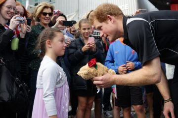His Royal Highness Prince Harry visits AUT Millennium Institute in Mairangi Bay Auckland, New Zealand, Saturday, May, 16, 2015. Prince Harry takes a teddy bear from Maddison Hailes as he leaves. (AAP Image/Herald On Sunday Pool/Doug Sherring) NO ARCHIVING