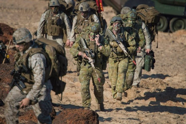 A supplied image obtained Saturday, July 11, 2015 shows ** Local Caption** Australian Army Soldiers, assigned to 2nd Battalion, Royal Australian Regiment, along with U.S. Marines, assigned to Battalion Landing Team, 2nd Battalion, 5th Marines, practice an amphibious assault during Talisman Sabre 2015 at Fog Bay, Australia, July 11, 2015. Talisman Sabre is a biennial exercise that provides an invaluable opportunity for nearly 30,000 U.S. and Australian Defence Force to conduct operations in a combined, joint and interagency environment that will increase both countries? ability to plan and execute a full range of operations from combat missions to humanitarian assistance efforts. (AAP Image/Daniel M Young/US Navy) NO ARCHIVING